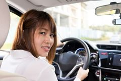 Woman driver sitting in car with smile - Get ready to drive. stock photography