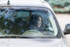 Woman Driver Sitting Waiting In Her Car. Royalty Free Stock Photo