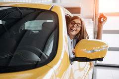 The woman driver smiling showing new car keys Stock Photo