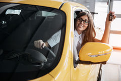 The woman driver smiling showing new car keys Stock Photography