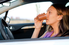 Woman driver stopping for a drink Stock Images