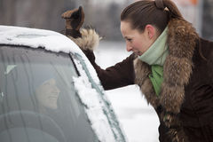 Woman driver talking with friend Stock Photography