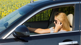 Woman driver talking on her mobile Royalty Free Stock Photography