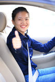 Woman driver thumb up in car Royalty Free Stock Photography
