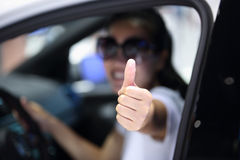 Woman driver thumb up Stock Images