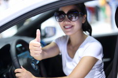 Woman driver thumb up Royalty Free Stock Images