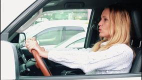 Woman driver in a traffic jam. Stressed woman driver in a traffic jam stock footage