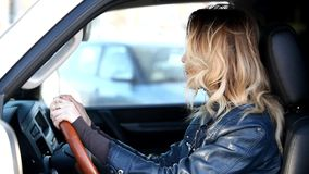 Woman driver in a traffic jam stock footage