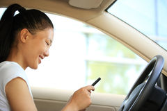 Woman driver use cell phone in car Royalty Free Stock Image