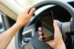 Woman driver use cell phone in car Stock Photo