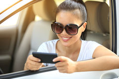 Woman driver use cell phone in car Royalty Free Stock Photography