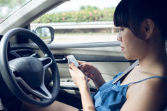 Woman driver using a smart phone Royalty Free Stock Images