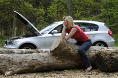 Woman driver waiting for roadside assistance Stock Photo
