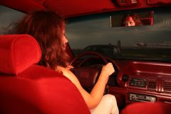 Woman on drivers seat Royalty Free Stock Images