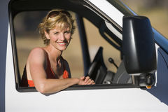 Woman in drivers seat of motor home, smiling, portrait Stock Images