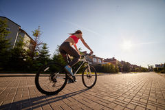 Woman drives on bike Stock Image