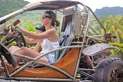 Woman drives a Buggy on a safari adventure tour in Rarotonga Coo Stock Photo