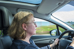 Woman drives the car concentrated on a german highway Royalty Free Stock Image
