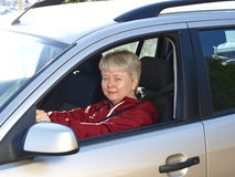 Woman driving. Middelage woman drivng in her car Royalty Free Stock Images