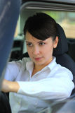 Woman is driving. Very concentration Royalty Free Stock Photos