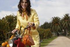 Woman Driving Bike Stock Photo
