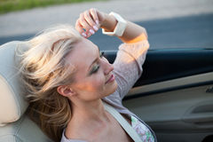 Woman driving cabriolet Stock Photos