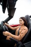 Woman is driving in a cabriolet Stock Image