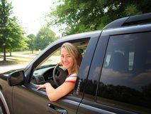 Woman Driving Car. A beautiful young woman driving a car, could be a soccer mom, or great auto insurance pic