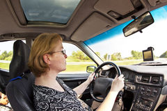 Woman is driving car Royalty Free Stock Photography