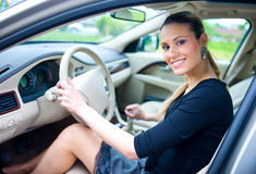 Woman driving car Stock Images
