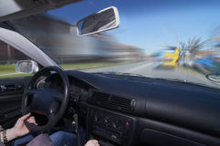 Woman driving a car. A woman driving a car behind a bus Stock Image