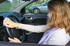 Woman driving a car Royalty Free Stock Photos