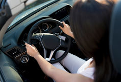 Woman driving a car Stock Photo