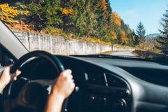 Woman driving car in carpathian mountains Royalty Free Stock Photos