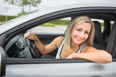 Woman driving a car - female driver at a wheel of a modern car Royalty Free Stock Photos
