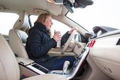 Woman driving a car - female driver at a wheel of a modern car, Stock Photos