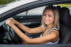 Woman driving a car - female driver at a wheel of a modern car Royalty Free Stock Image