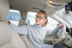 Woman driving a car - female driver at a wheel of a modern car, Stock Photography