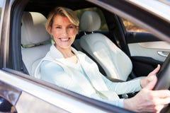 Woman driving car Stock Photos