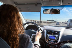 Woman driving car on highway, inside view Stock Images