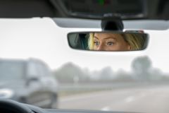 Woman driving a car on a highway stock images