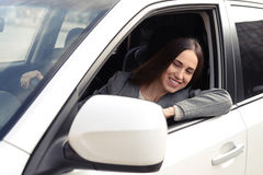 Woman driving a car and looking at rearview mirror Royalty Free Stock Photos