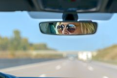 Woman driving a car on a motorway royalty free stock photo