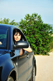 Woman driving a car outdoors Stock Photo