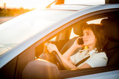 Woman driving car on phone Royalty Free Stock Images