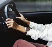 Woman driving a car on a road royalty free stock photos