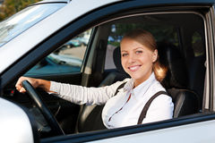 Woman driving the car and smiling Stock Images