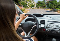 Woman driving a car Stock Image