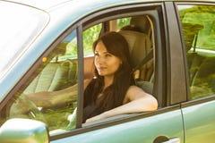 Woman driving car. Summer vacation trip travel. Stock Photos
