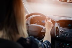 Woman driving car at sunny day. Modern car interior Royalty Free Stock Image